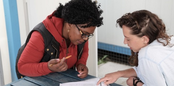Image of a researcher and study participant reading an informed consent document